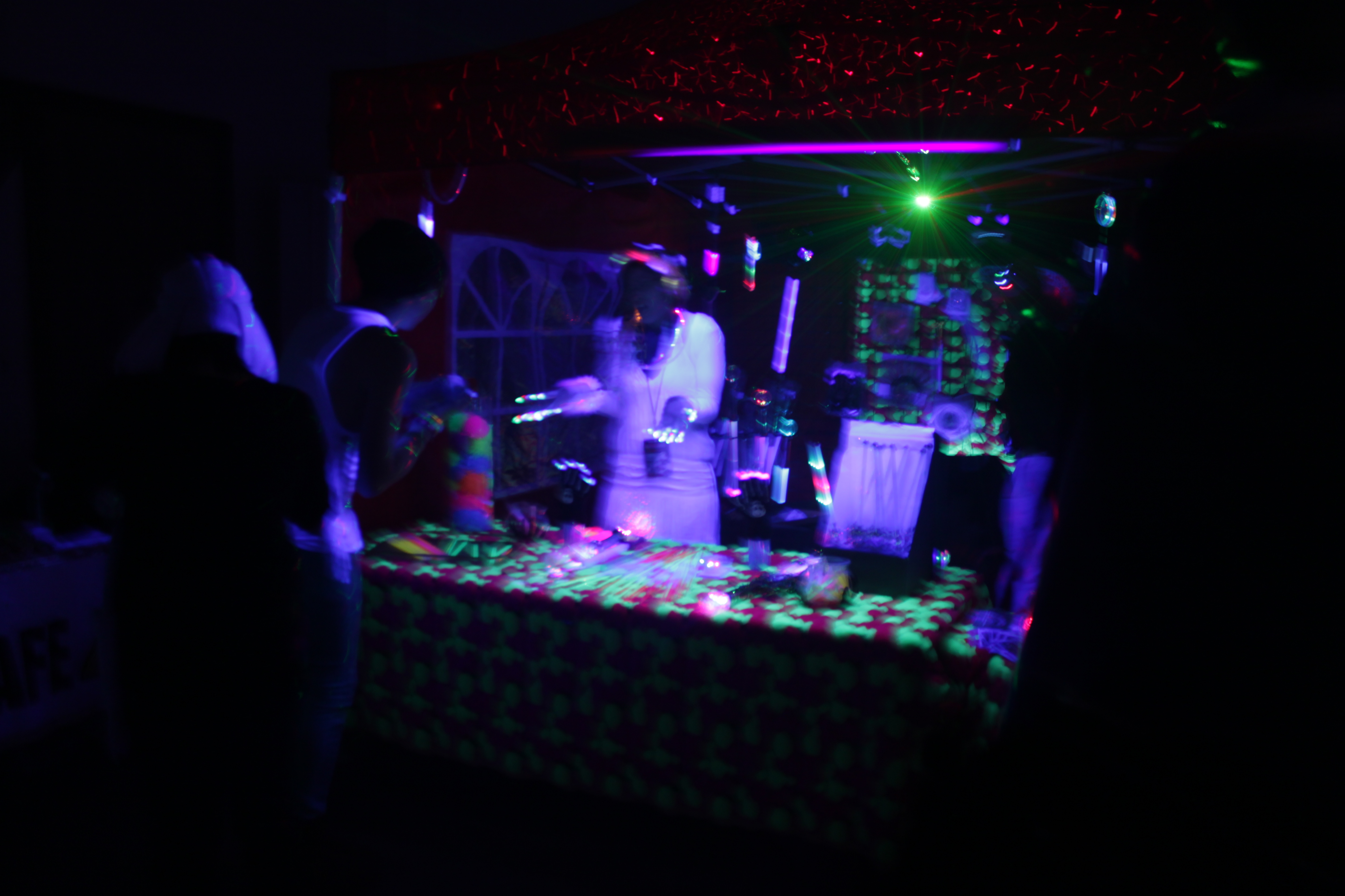 The Hyper Glow Booth Working Behind The Rave Beer For